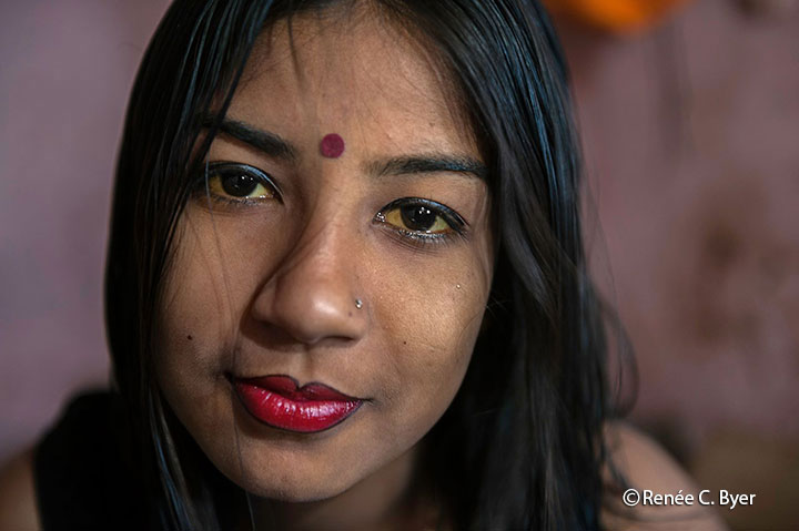 "Nupur, 20, is featured in ""Living on a Dollar a Day"". She has resorted to working a Bangladesh brothel."