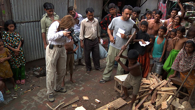 Boy in Bangladesh working with axe