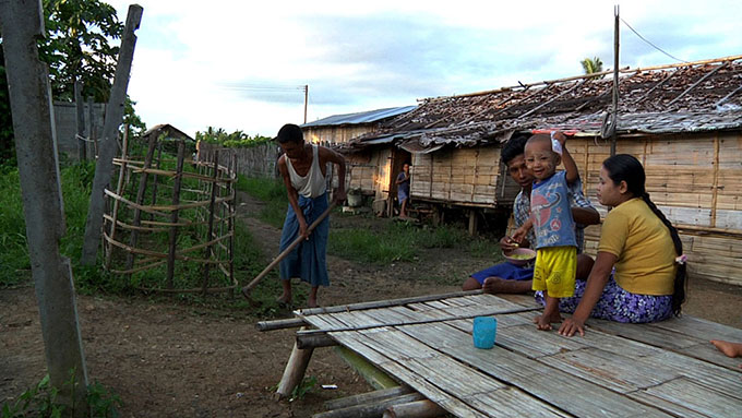 Burmese family outside home