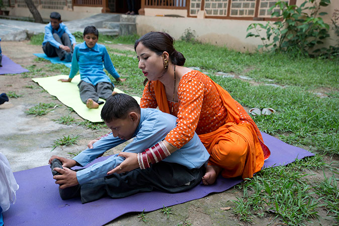 Directed yoga helps the students to stretch and take better control of their bodies. In addition to this work with the students, the Harmony program also works with the families in order to develop the best strategies for supporting the children.